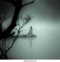 alone-girl-lonely-ocean-rocks-Favim.com-324928